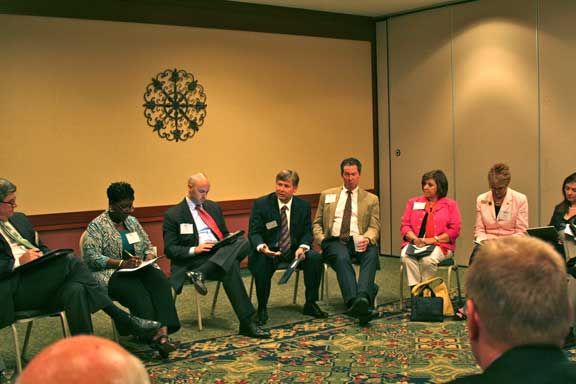 Participants at the Board Forum split into small groups